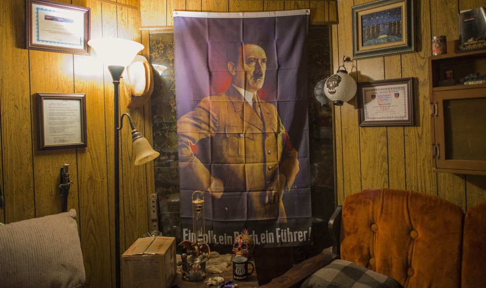 An image of Adolf Hitler hangs inside a home where members affiliated with the Ku Klux Klan and the National Socialist Movement were gathering for a joint rally in Hunt County, Texas, in 2014.