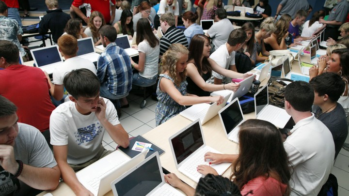 Rows of students using laptops.