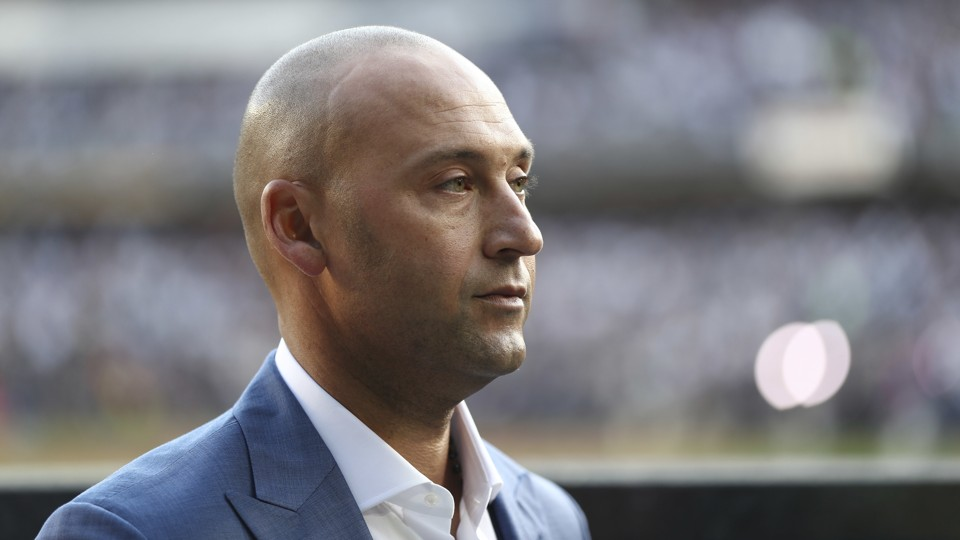 Derek Jeter participates in a ceremony to retire his number at Yankee Stadium