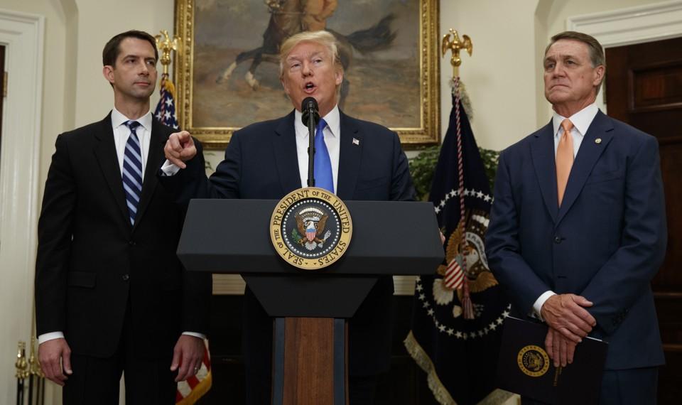 President Trump flanked by Senators Tom Cotton and David Perdue