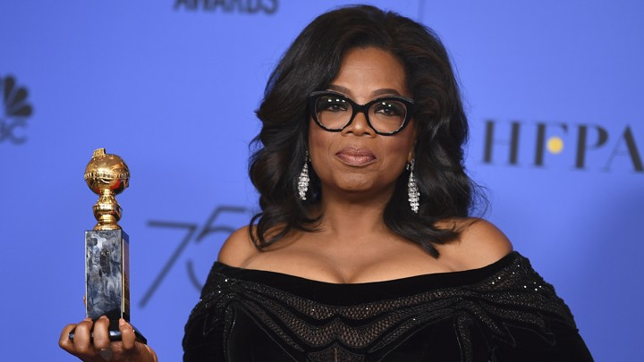 Oprah Winfrey stands with her Golden Globes award.