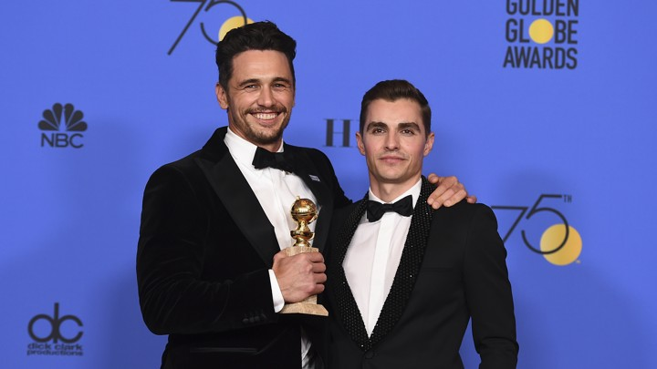 James Franco and Dave Franco pose after the former wins the Golden Globe for Best Actor in a Drama for 'The Disaster Artist'