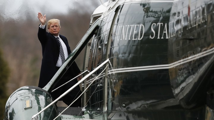 President Trump, waving, boards Marine One.