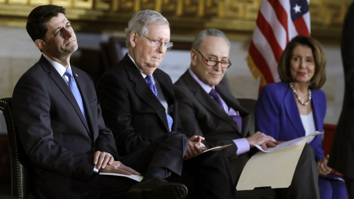House Speaker Paul Ryan, Senate Majority Leader Mitch McConnell, Senate Minority Leader Chuck Schumer, and House Minority Leader Nancy Pelosi seated together