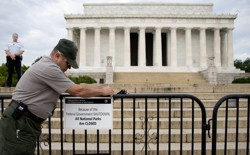 A National Parks worker in front of the blocked-off Lincoln Memorial in Washington, D.C.