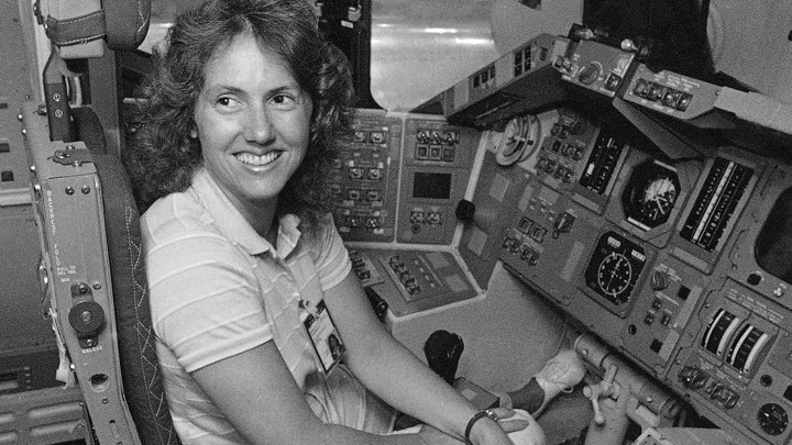 Christa McAuliffe tries out the commander's seat in a shuttle simulator at the Johnson Space Center in Texas on September 13, 1985.