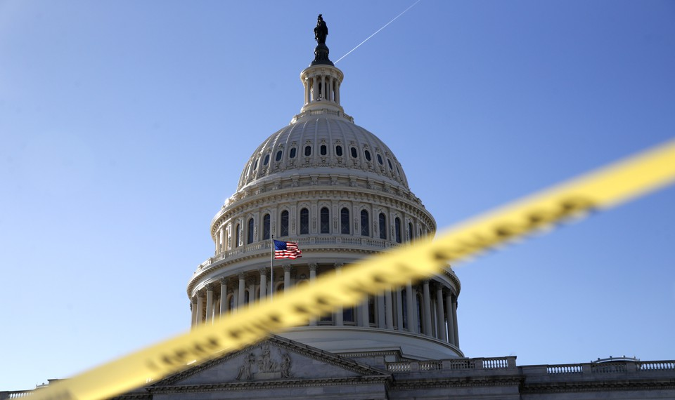 The Capitol dome framed by yellow police tape