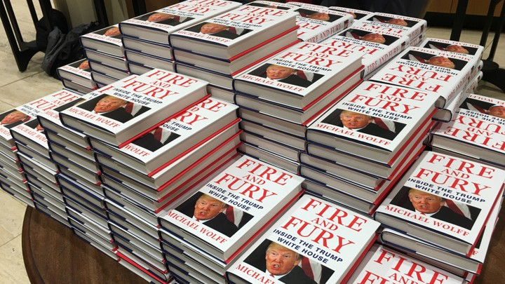 "Copies of ""Fire and Fury: Inside the Trump White House"" are stacked at Waterstones book store in London on January 9, 2018."
