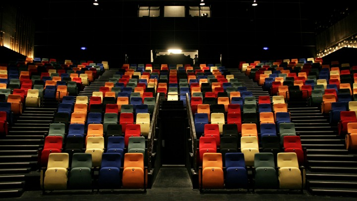 A colorful array of seats in a movie theater