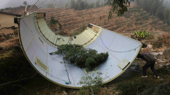 A piece of a Long March 3B rocket after it fell in a field in China's central Jiangxi province on December 11, 2016