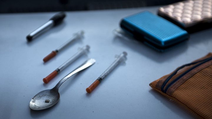 Drug paraphernalia, including a spoon and syringes