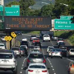 sign on a highway in Honolulu clarifies that the emergency nuclear missile alert was a false alarm.
