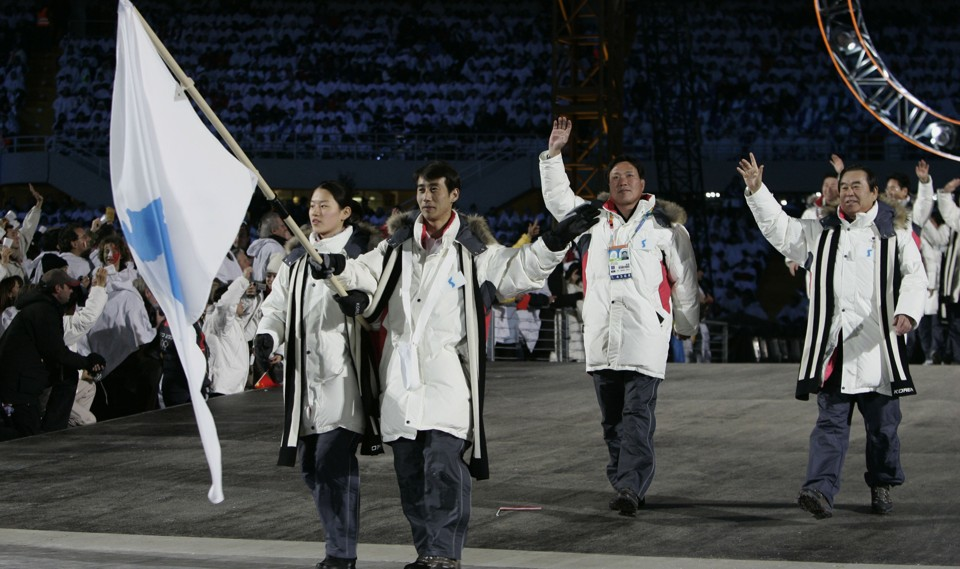 North and South Korean athletes march together at the 2006 Winter Olympics.
