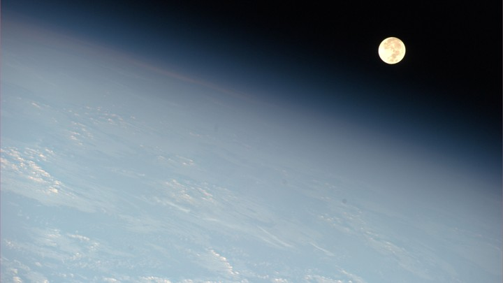 The moon seen through Earth's outer atmosphere