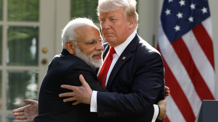 India's Prime Minister Narendra Modi hugs U.S. President Donald Trump as they give joint statements in the Rose Garden of the White House in Washington, D.C., June 26, 2017