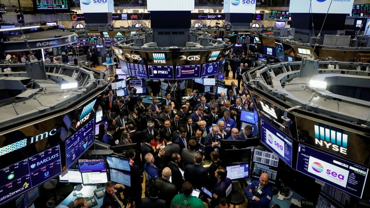Traders gathering on the floor of the New York Stock Exchange