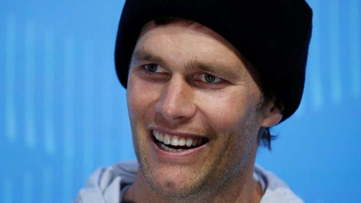 New England Patriots quarterback Tom Brady speaks to reporters during Super  Bowl Opening Night in St. Paul be2841a72