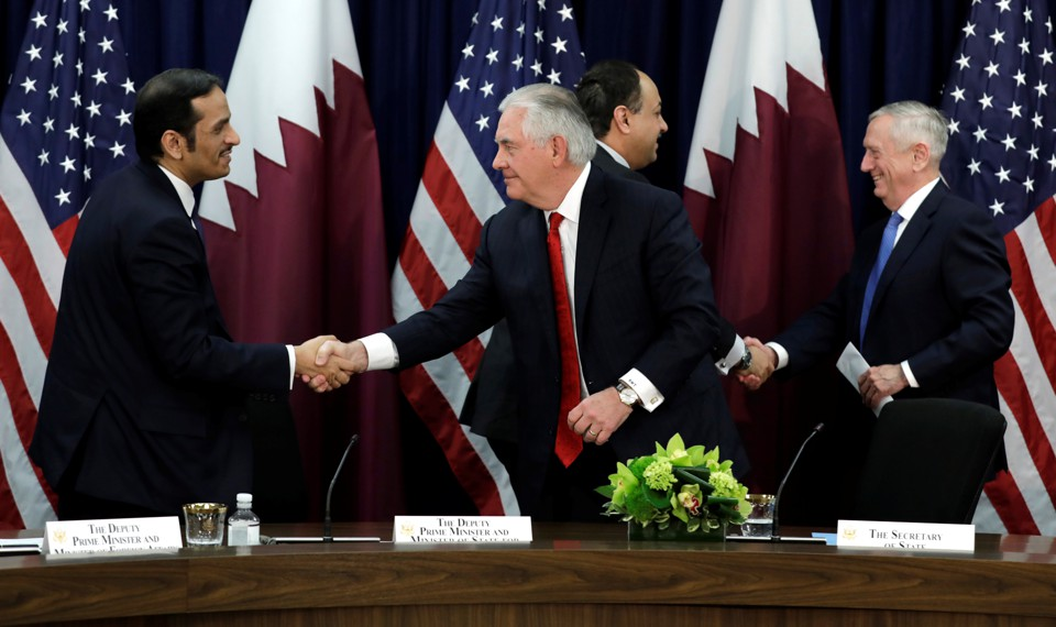 The U.S. secretaries or state and defense shake hands with their Qatari counterparts in Washington.