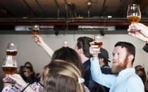 Visitors taste beer at Brooklyn Brewery, in New York