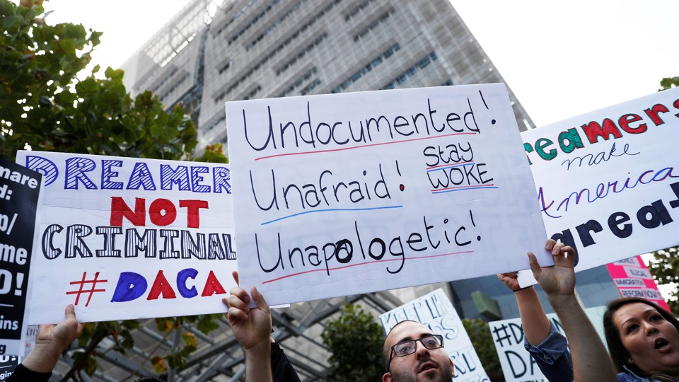 Demonstrators rally against the rescindment of DACA outside the San Francisco Federal Building on September 5.