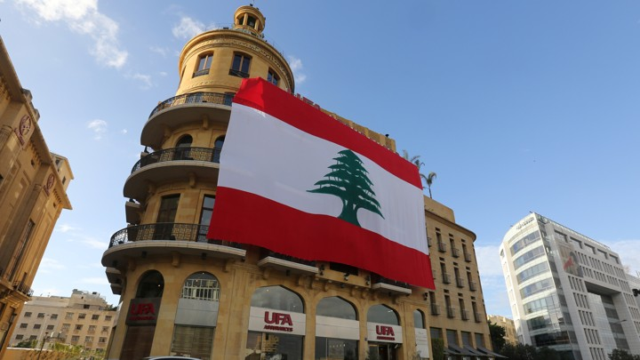 A Lebanese flag hangs from a building in downtown Beirut.