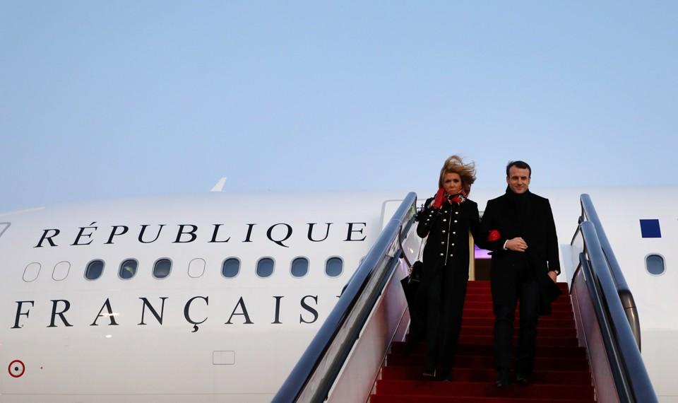President Emmanuel Macron and his wife Brigitte Macron arrive at Beijing Capital Airport.