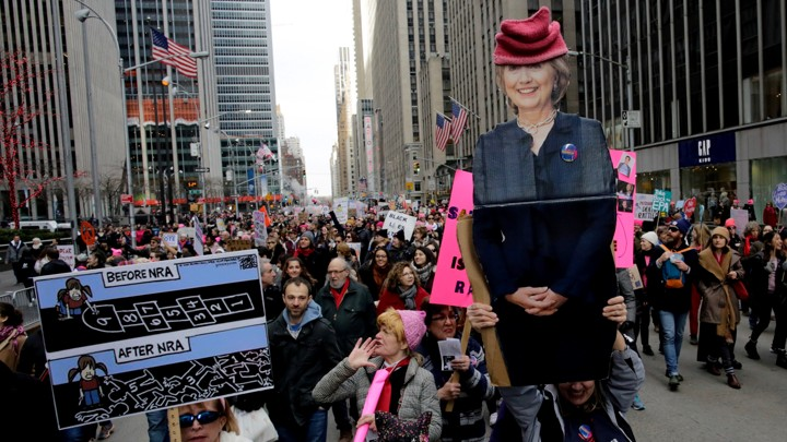 People carrying a poster of Hillary Clinton take part in the Women's March in Manhattan in New York City, New York, U.S., January 20, 2018