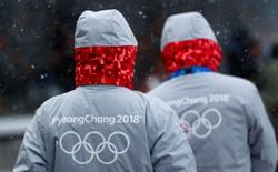 Volunteers for the upcoming 2018 Pyeongchang Winter Olympic Games walk in Pyeongchang.