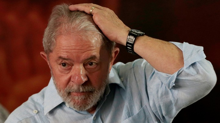60678db1a800b Luiz Inacio Lula da Silva reacts during a meeting with members of the  Workers Party, that decided Lula da Silva will be its candidate again in  the 2018 ...