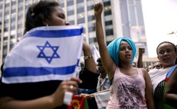 A migrant from Eritrea gestures during a protest in Israel.