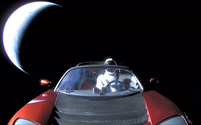write my essay please the atlantic the dummy astronaut starman wearing a spacex space suit in the driver s seat of