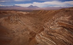 The dry, red, rocky landscape of the Atacama Desert.