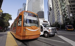 A streetcar with the Amazon logo on a Seattle street
