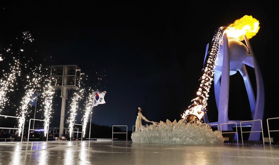 South Korean Olympic figure skating champion Yuna Kim lights the Olympic flame