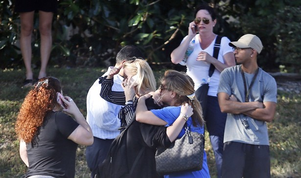 Anxious family members wait for news of students caught in a school shooting.