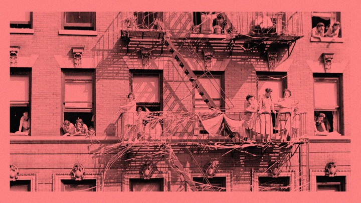 An Antique Photo Of Families And Children Looking Out The Windows Of An  Apartment Building And