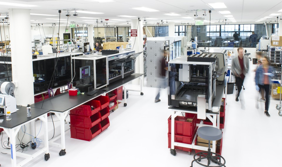 A brightly lit, colorful lab space