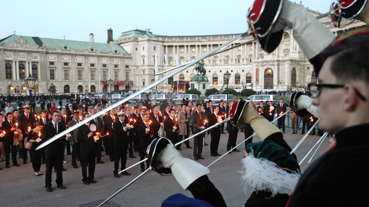 Members of traditional Austrian fraternities hold torches and raise their swords during a commemoration ceremony for the victims of World War II in Vienna in 2012.