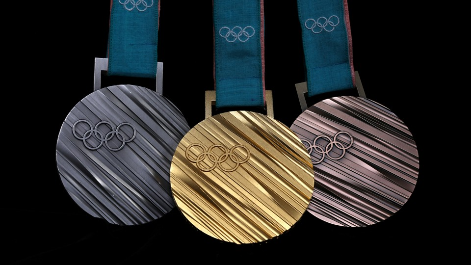 Three Pyeongchang 2018 Olympic medals on a black background