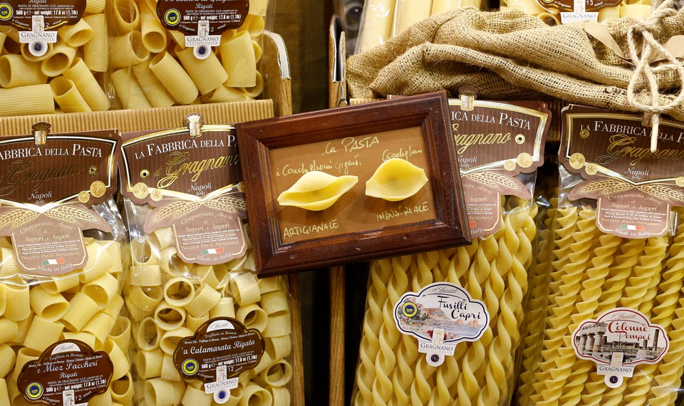 Various pasta shapes in small plastic packages
