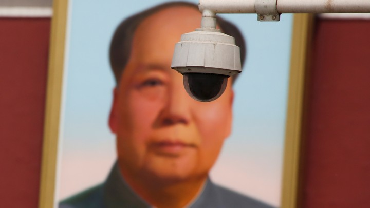 63f2635e2f A security camera is attached to a pole in front of the portrait of former  Chinese Chairman Mao Zedong on Beijing s Tiananmen Square
