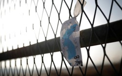 A Korean unity flag hangs on a fence in the demilitarized zone separating the two Koreas.