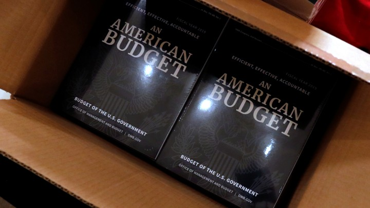 Copies of President Trump's fiscal 2019 budget proposal in a cardboard box