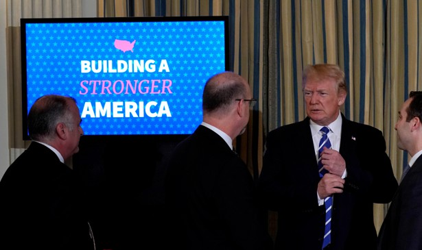 President Donald Trump speaks to attendees during an infrastructure initiative meeting.