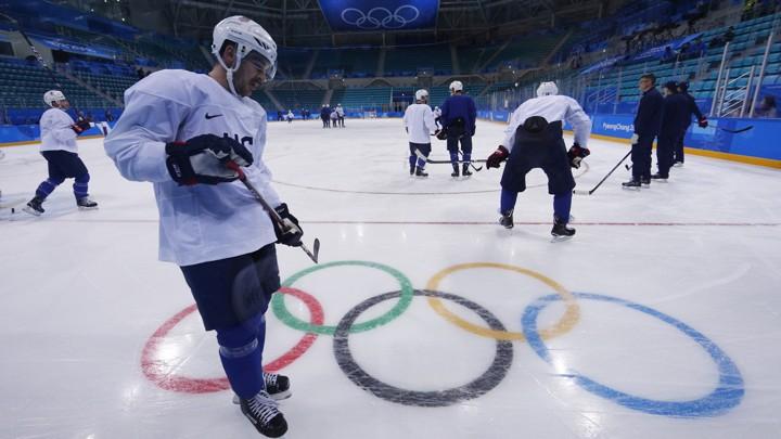 Members of the U.S. men's ice hockey team team train.
