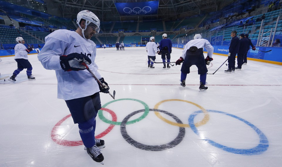 Members of the U.S. men's ice hockey team team train.