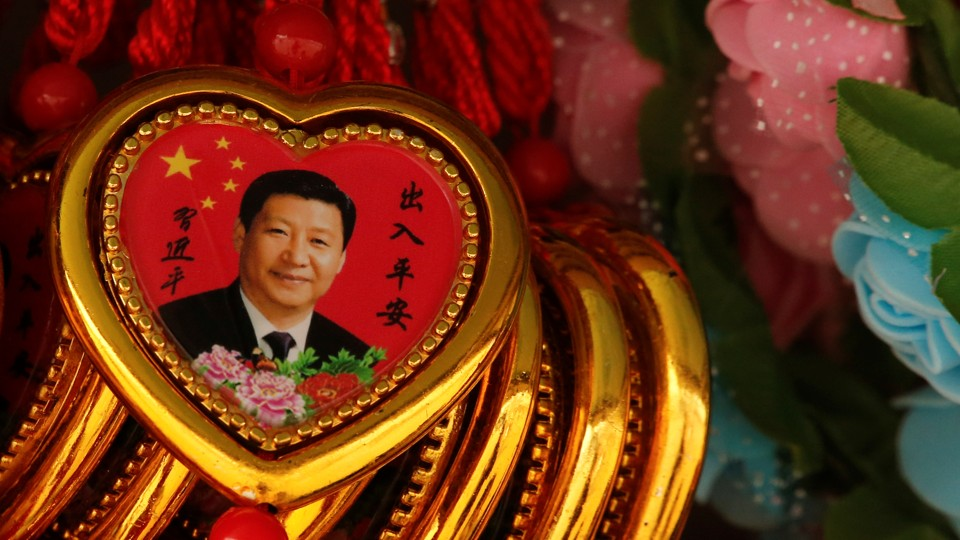 A Souvenir necklacewith a portrait of Chinese President Xi Jinping