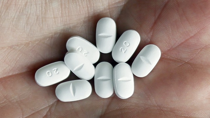 White pills resting in a palm