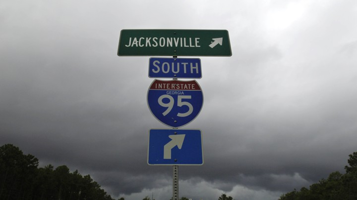 Blue and green I-95 interstate signs on a stormy day