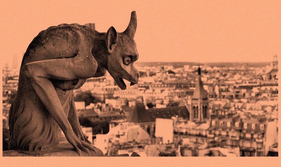 A photograph of a gargoyle overlooking Paris